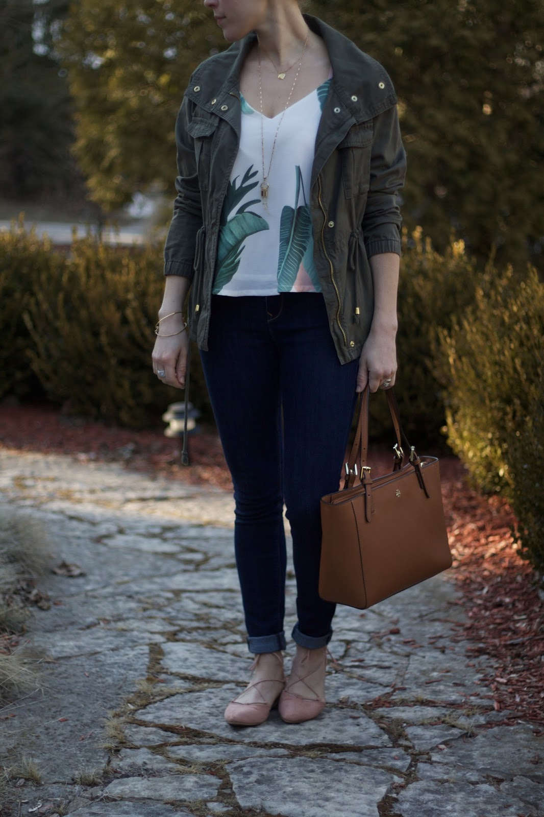 spring time look with layers, palm print cami, olive green utility jacket, Tory Burch tote, blush lace up flats