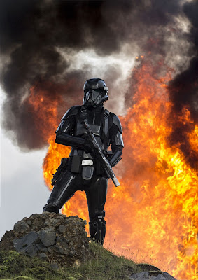 Death Trooper, standing before a fireball