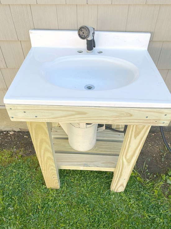 Outdoor sink with white bathroom sink.