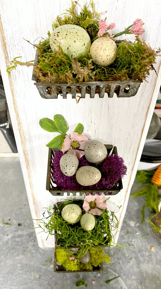 Repurposed cutting board soap baskets with colored moss and eggs