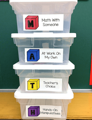 Photo of Guided Math storage bins with labels.