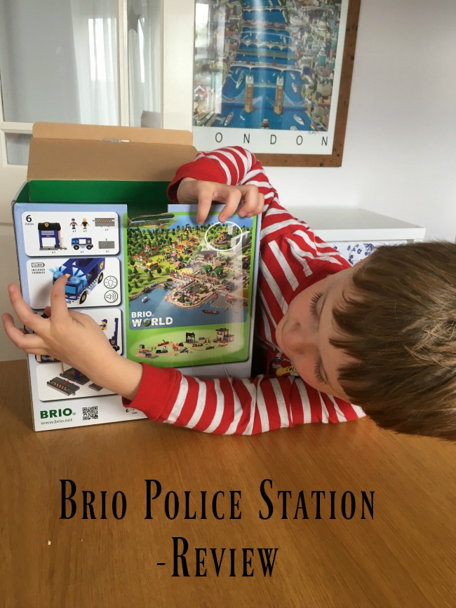Brio-police-station-review-text-over-image-of-boy-pointing-to-police-car-on-box