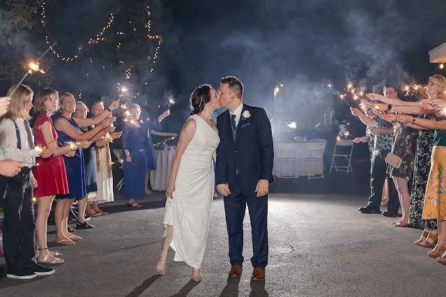 wedding sparkler exit at a backyard az wedding in july