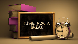 Clipart Image of a Time for a Break Sign Beside a Stack of Books and an Alarm Clock
