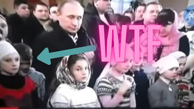 Demon boy behind Putin.