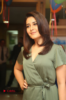 Actress Raashi Khanna Stills in Green Short Dress at Mirchi 95 Suno Aur Mercedes Jeeto Contest  0064.JPG