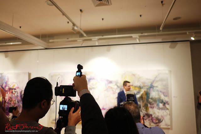 Videoing the opening night - Beyond the Light - Chinese Artist He Zige - Photos By Kent Johnson for Street Fashion Sydney.