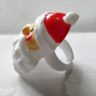 Red and white Father Christmas plastic ring from Greggs