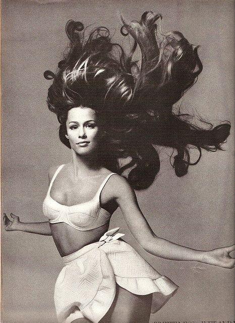 B&W photo of Lauren Hutton and her hair in flight, Vogue Magazine June 1968