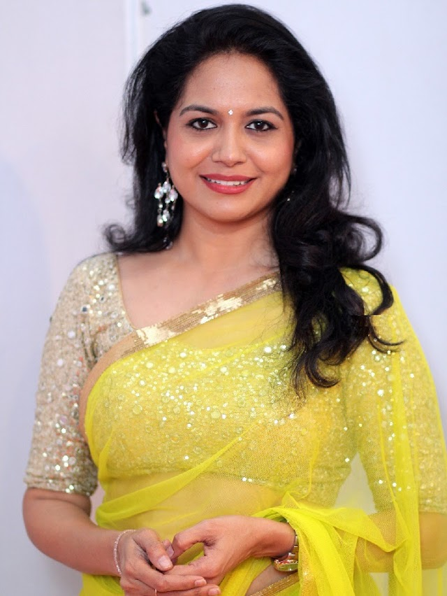 Tollywood Singer Sunitha Stills In Transparent Yellow Saree and Golden Matching Blouse