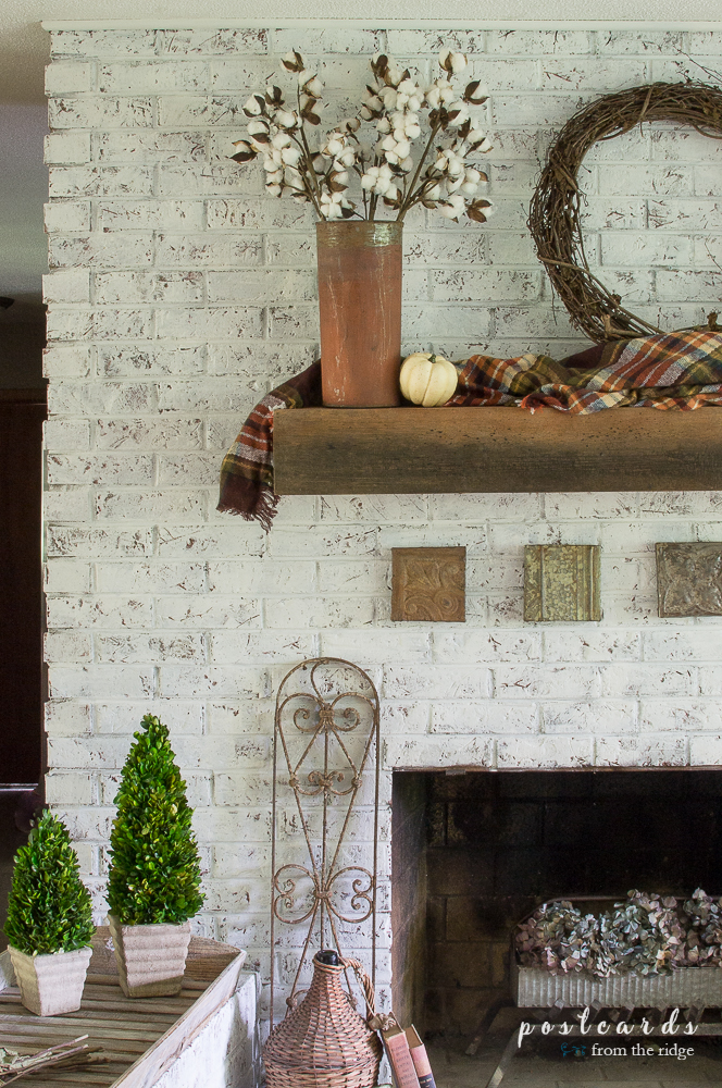 Lots of charming ways to add French farmhouse decor to your fall fireplace.