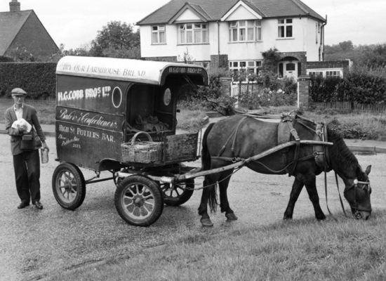 Photograph of Mr Barnes roundsman of Cobb's the bakers delivering in Swanley Bar Crescent 1961.
