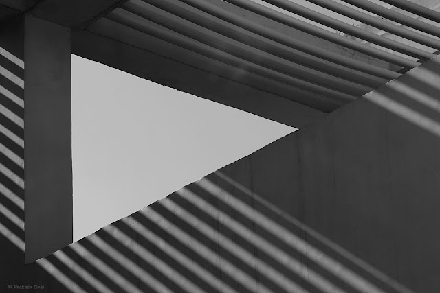 A Black and White Look-up Minimalist Photo of Lines and Triangle shot at Jawahar Kala Kendra, Jaipur