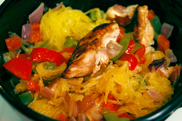 yellow spaghetti squash with red & green bell peppers, purple onions, chicken and parmesan
