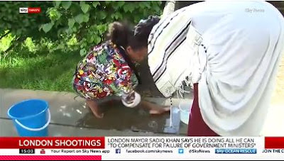 PHOTO: Woman Spotted Cleaning Her Son's Blood From Pavement After He Was Murdered