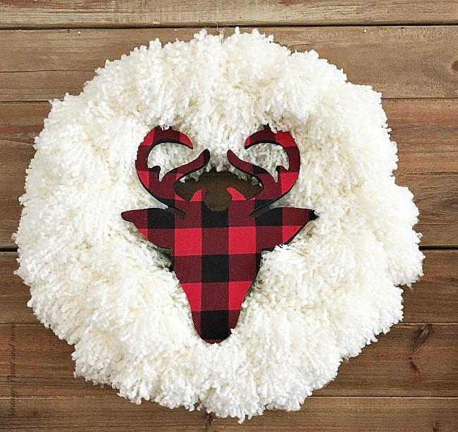 Vintage, Paint and more... a DIY Farmhouse Christmas Wreath made with a yarn wreath and a buffalo plaid deer head silhouette