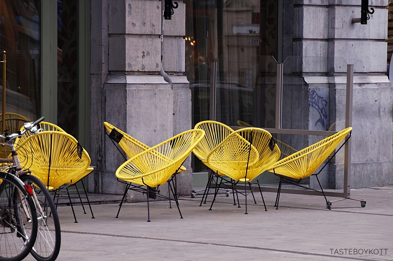 Yellow Acapulco Chairs in Brussels, belgium