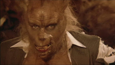 Silver Bullet 1985 horror movie still where Reverend Lowe turns into a werewolf and is ready to find its next victim