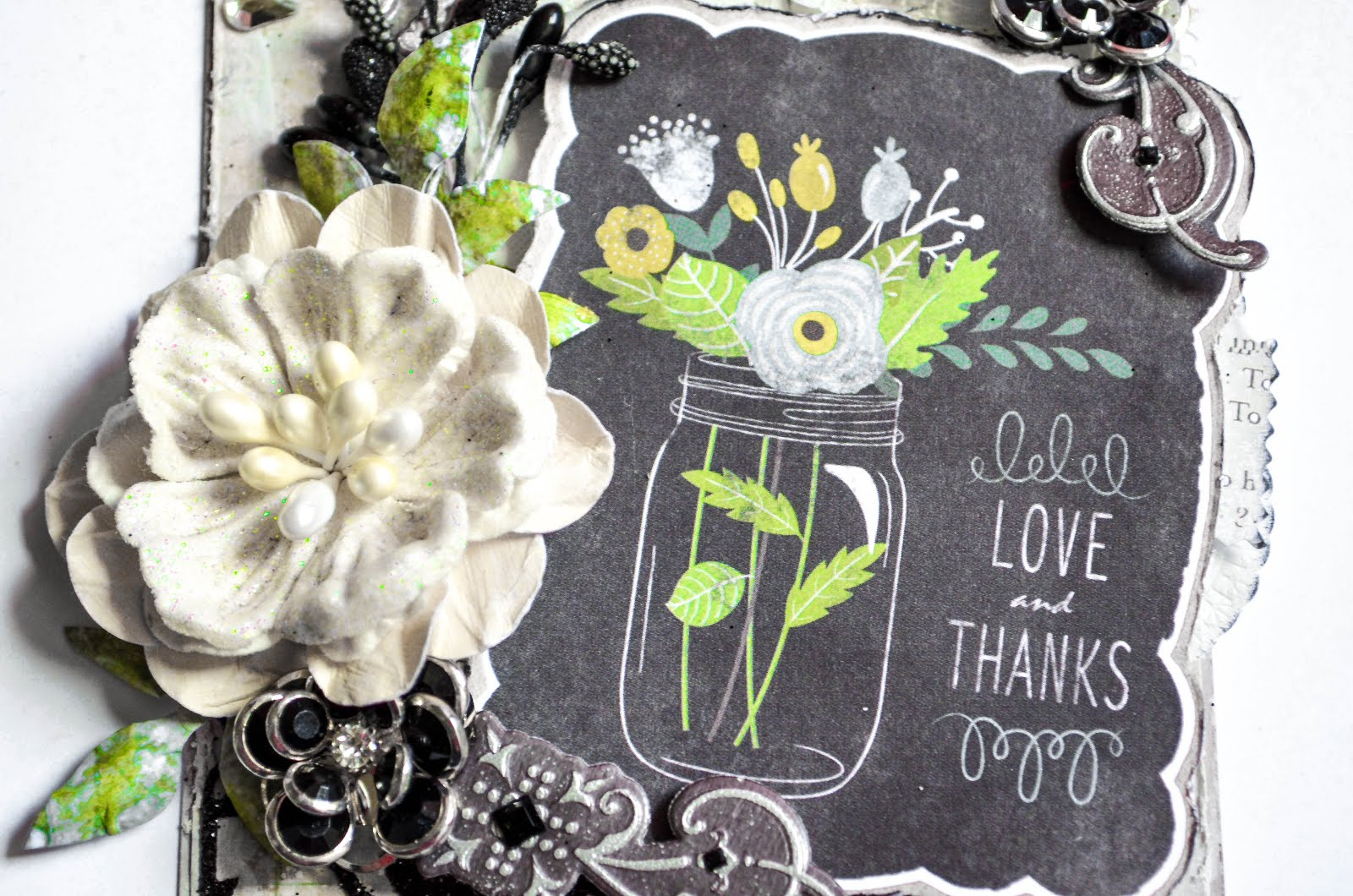 Elegant black and white chalkboard mixed media tag with die cuts and handmade flower