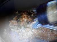 adding seasoning to pasta image