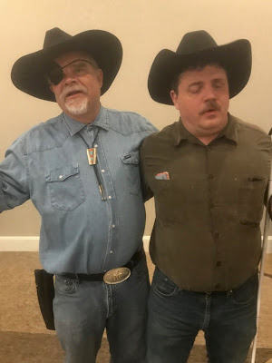 Kevan Worley dressed as Rooster Cogburn and his cowboy sidekick Scott LaBarre, President National Federation of the Blind of Colorado at the 2019 NFBCO State Convention Boot Scootin' Boogie