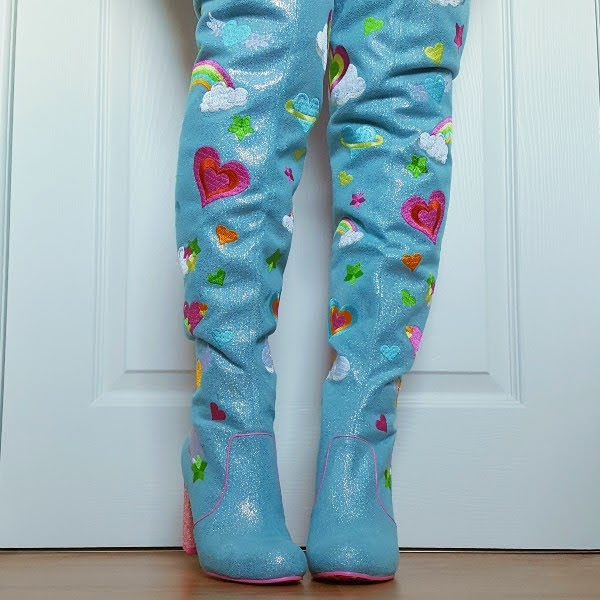 front wearing blue over the knee boots with embroidered details