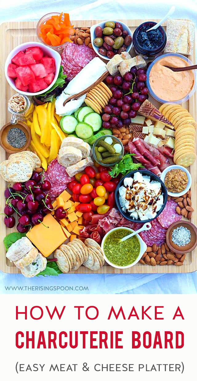 Need an easy & eye-catching no-cook appetizer for summer parties, a backyard BBQ, holidays (like Memorial Day, Fourth of July & Labor Day), camping & picnics? Learn how to assemble a simple charcuterie board (meat & cheese tray) with seasonal ingredients in 30 minutes. This one features cured meats, hard and soft cheeses, fresh produce like grapes, watermelon, cucumber & heirloom tomatoes, plus sweet & savory nibbles so there's a variety of flavors. Keep reading for lots of ideas & tips!