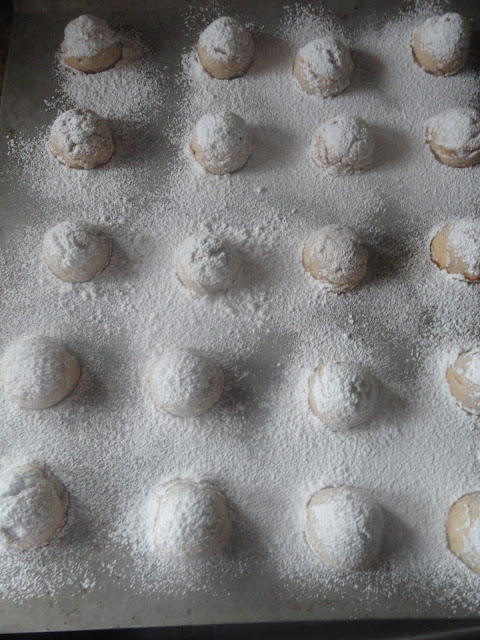 Russian-Tea-Cakes-Or-Mexican-Wedding-Cakes-Coat-Powdered-Sugar.jpg