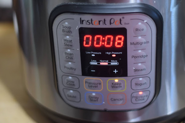 The instant pot set on HIGH pressure for 8 minutes.
