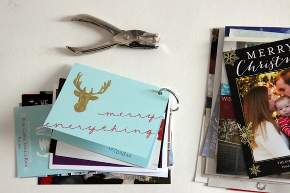 Just hole punch and then slip each card on the ring until all of your Christmas cards are in the book!