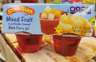 An unopened 4-pack of Sunny Farm Mixed Fruit in Black Cherry Gel fruit cups