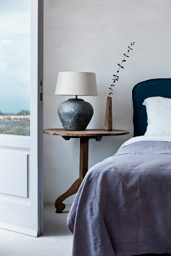 Dark blue details in the bedroom | Image by Emily Andrews via Remodelista