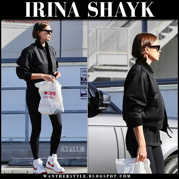 Irina Shayk in black burberry bomber jacket, black leggings and nike sneakers model off duty style december 27