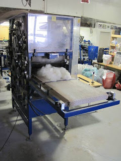 Machine for preparing alpaca wool.