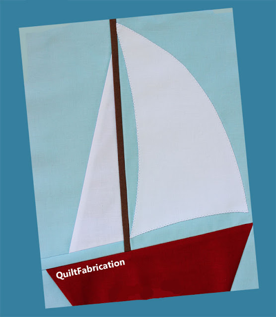 red and white sailboat