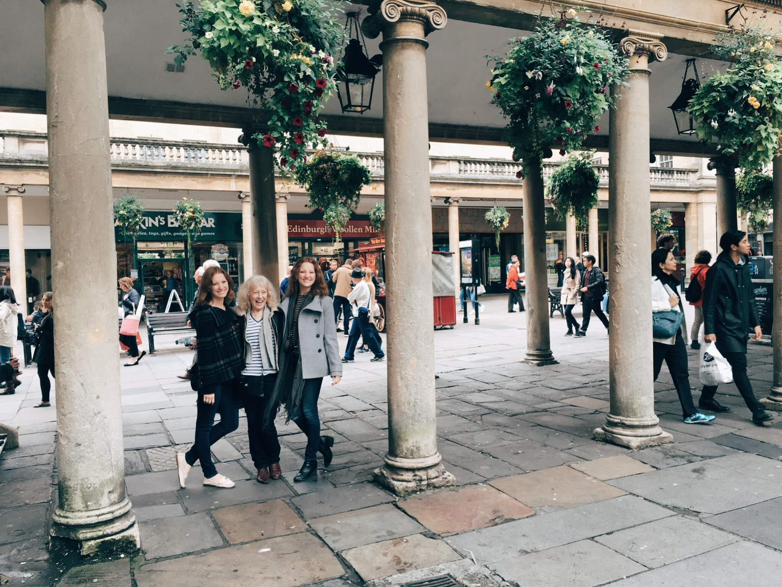 Tourists next to columns in Bath
