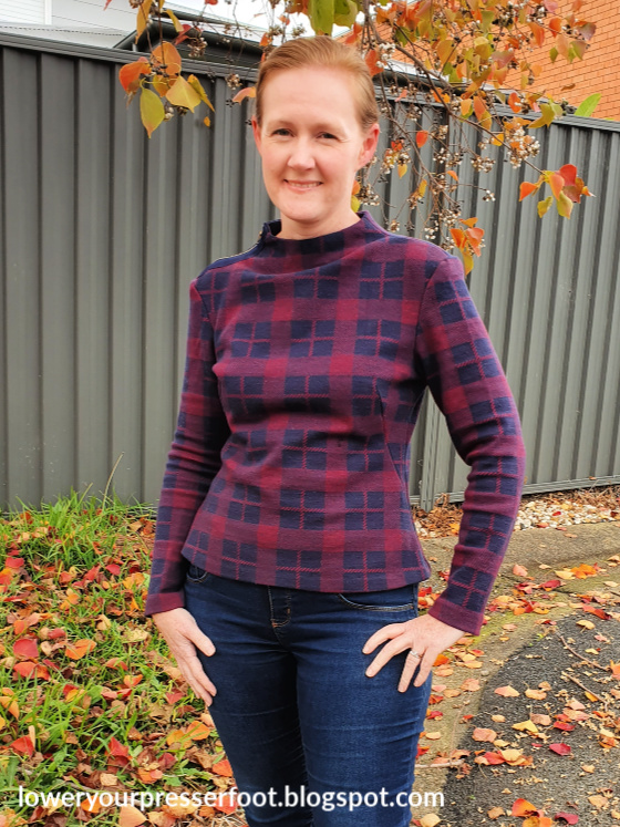 woman posing in a maroon plaid check long sleeve top