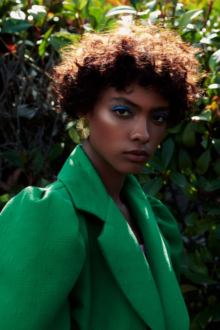 Fashion editorial with beautiful black model wearing green jacket