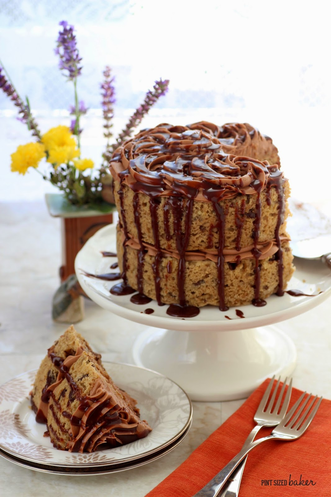 Bake this banana cake in two 6-inch cakes or one 9-inch cake, cover it in chocolate frosting and then drizzle it with melted chocolate hazelnut sauce.