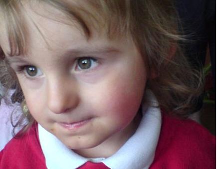 My youngest in her school uniform