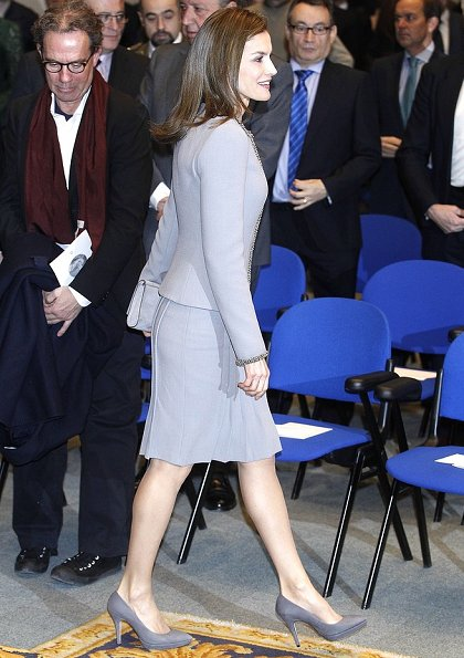 Queen Letizia wore Felipe Varela skirtsuit, Magrit Suede grey pumps, Magrit Clutch bag, diamond earrings