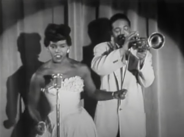 Faye Adams singing with a trumpet player