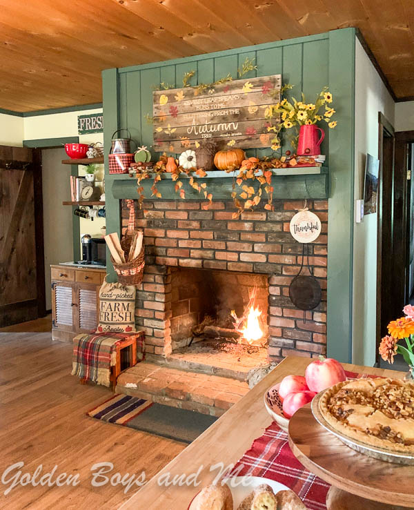 Backwoods Green by Benjamin Moore paint on brick fireplace at a mountain cabin.