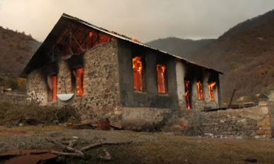 Ethnic Armenian villagers burn houses