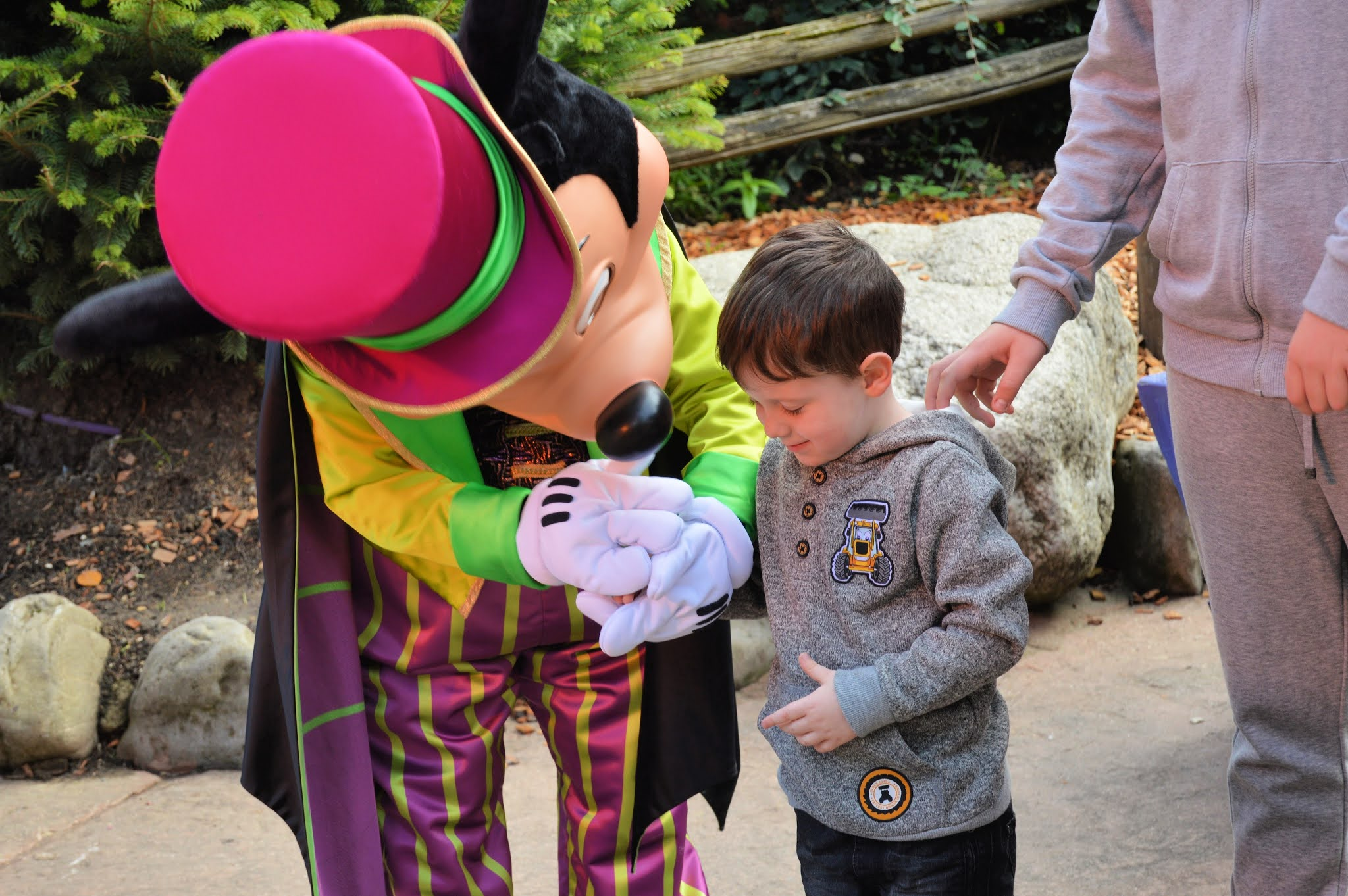 Little boy with Mickey at Disneyland Paris