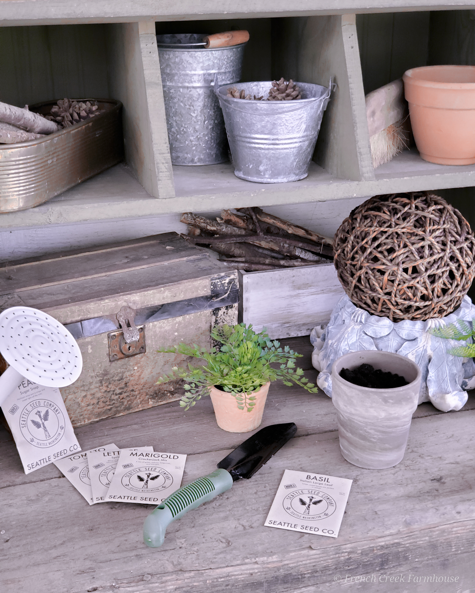I use a chicken nesting box to organize the supplies I need for the garden