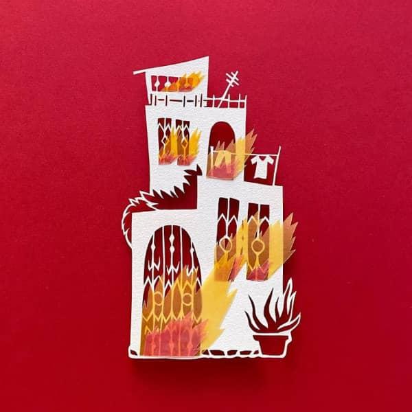 papercut huis met velijn vlammen schieten uit deuren en ramen
