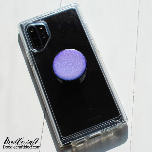 Color Shift Pop Socket with Resin DIY Make a fun custom POP Socket craft using color shift pigment and Envirotex Lite Pour-On High Gloss Finish. Make your pop socket shine in the sunlight with this simple resin DIY. This fun craft makes a great handmade gift too!