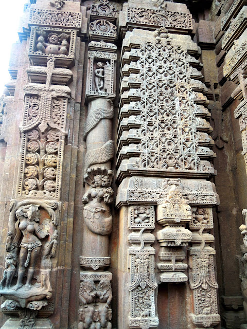 Miniature temples, nagas, and nayikas. Mukteshwar Temple, Bhubaneshwar