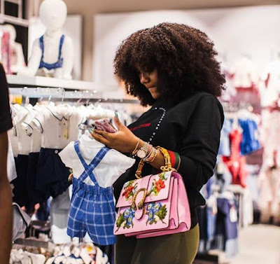 Pregnant Chioma shopping for her unborn baby